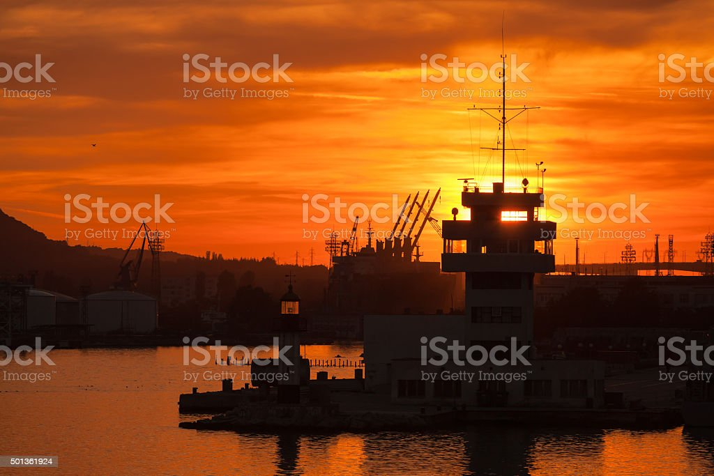 Silhouettes of cranes and buildings in Varna port stock photo