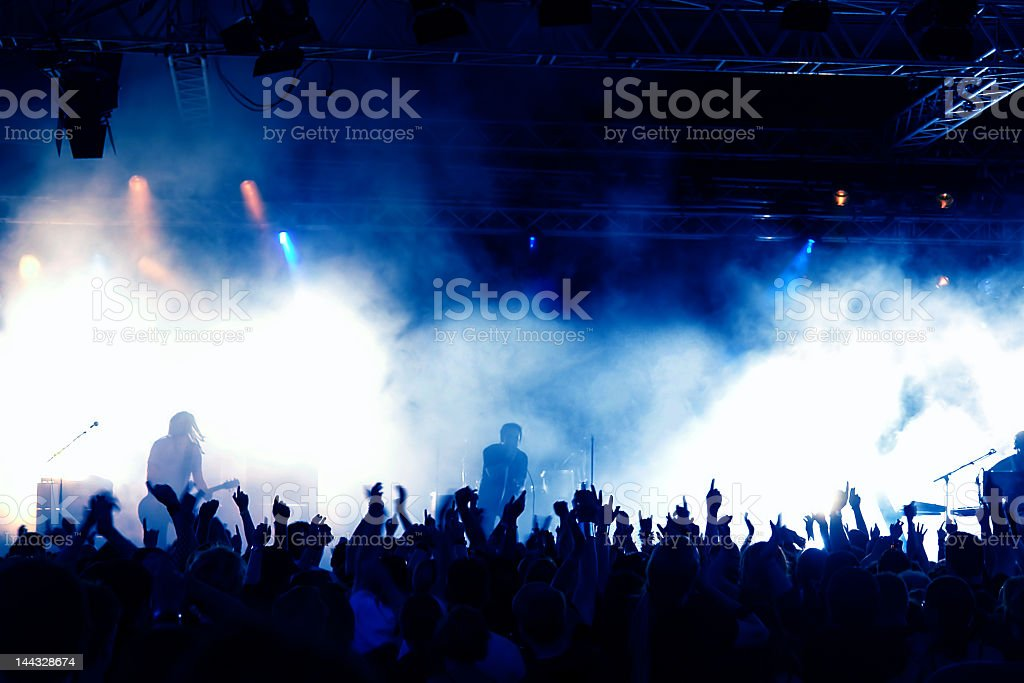 Silhouettes of crowd in a concert royalty-free stock photo
