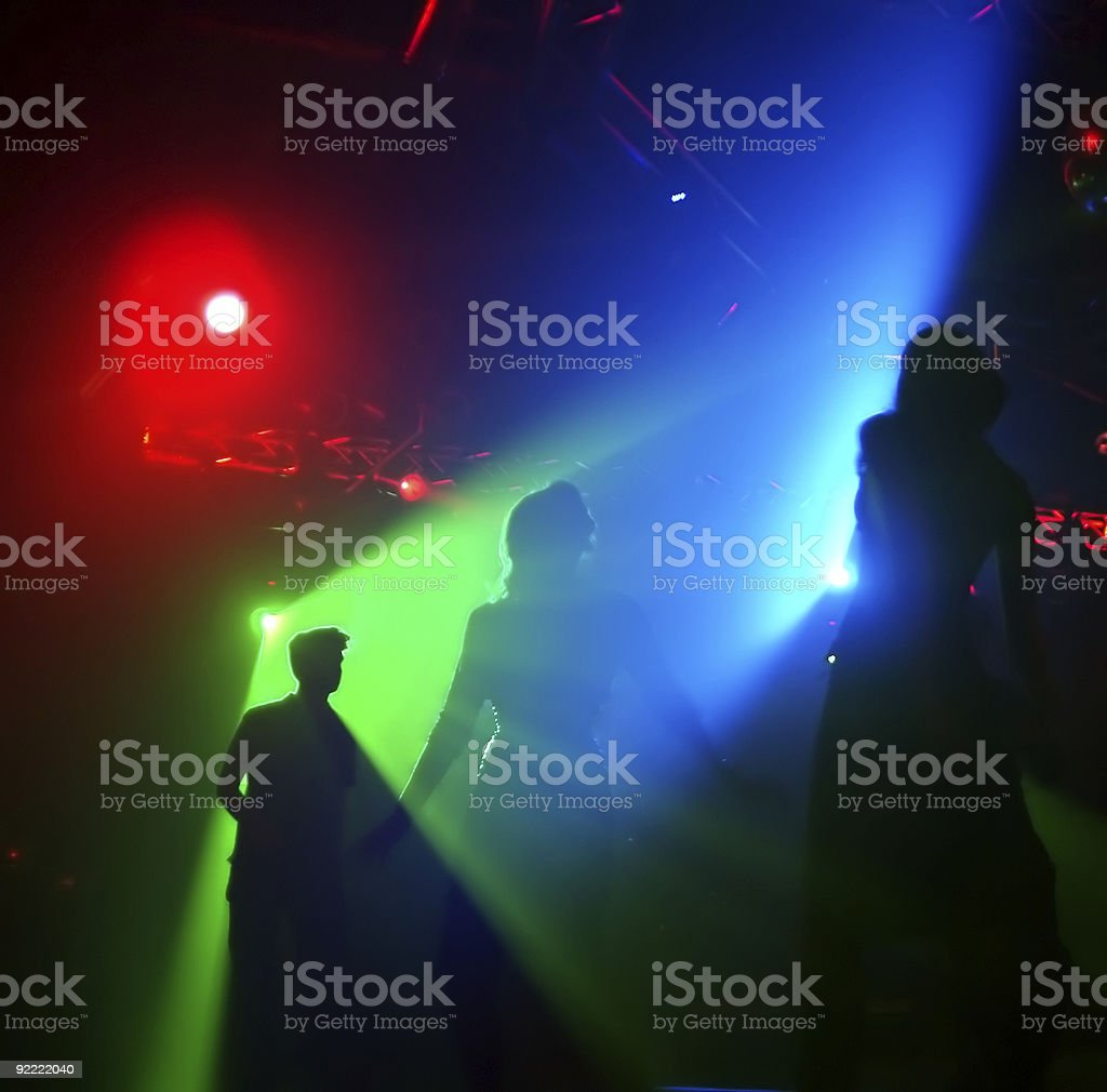 Silhouettes of dancing people royalty-free stock photo