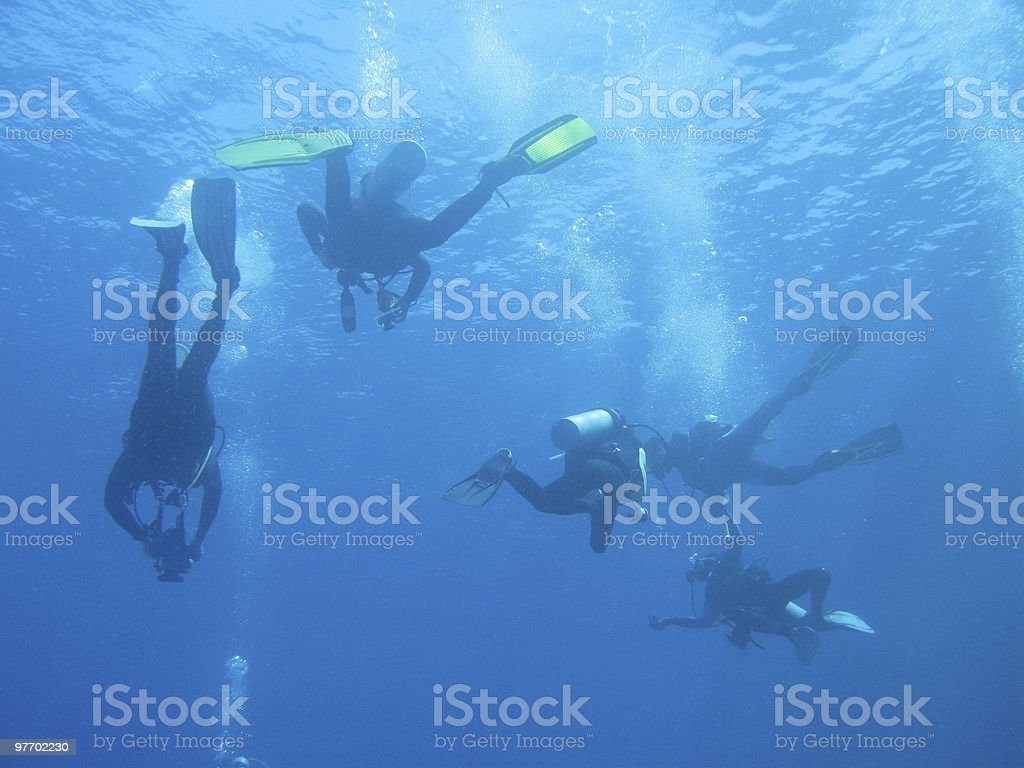 Silhouettes of Divers stock photo