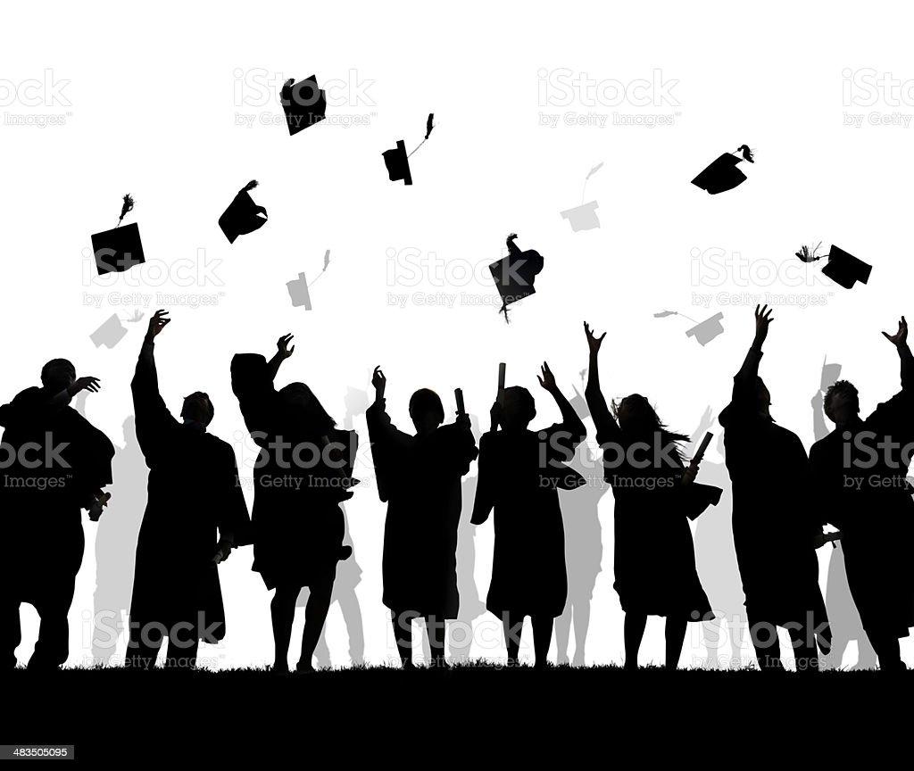 Silhouettes of Diverse International Students Celebrating Graduation stock photo