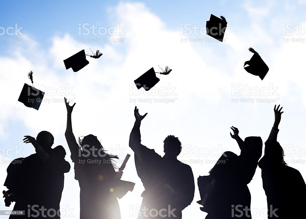 Silhouettes of Diverse International Students Celebrating Graduation stock photo