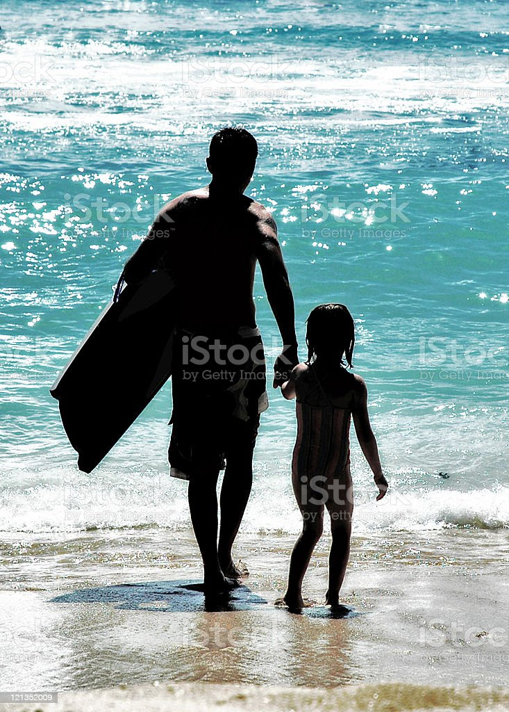 Silhouettes of Father and Daughter: Summer Day on the Beach royalty-free stock photo