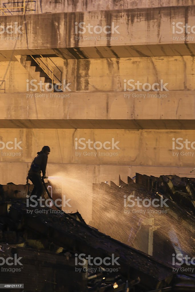 Silhouettes of  firemen before a fire stock photo