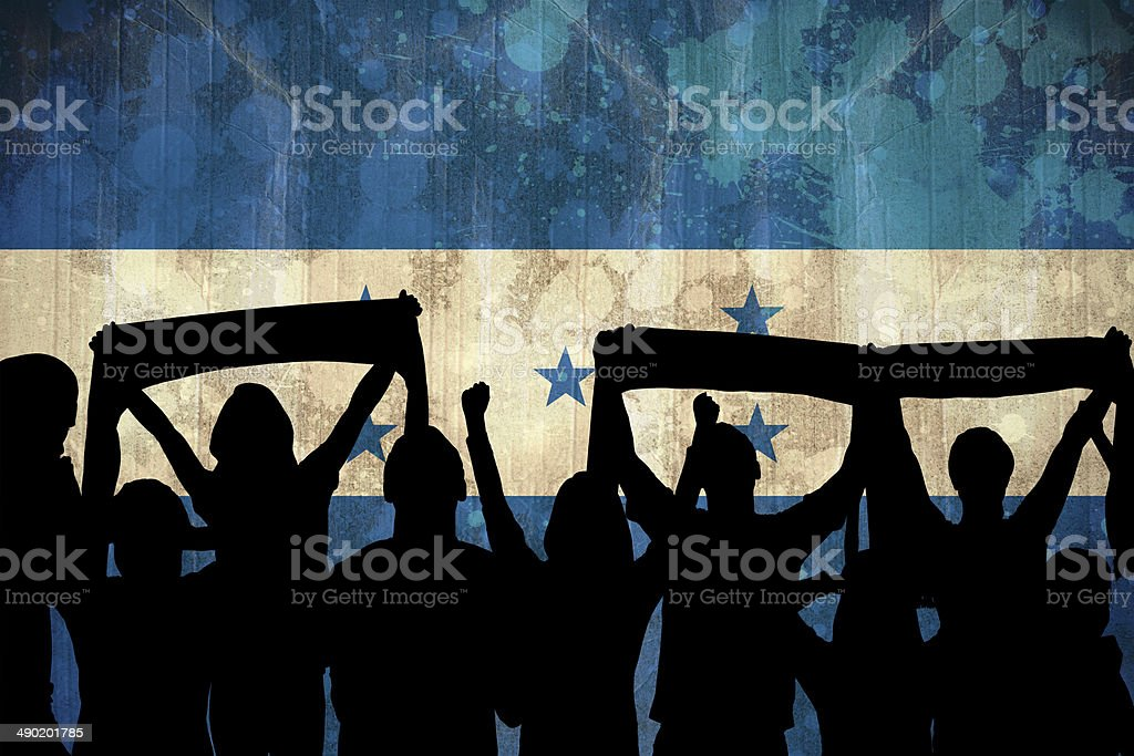 Silhouettes of football supporters stock photo