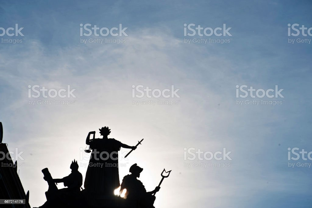 Silhouettes of Justitia and Other Ancient Greek Symbols on a Swedish town (Council) hall stock photo