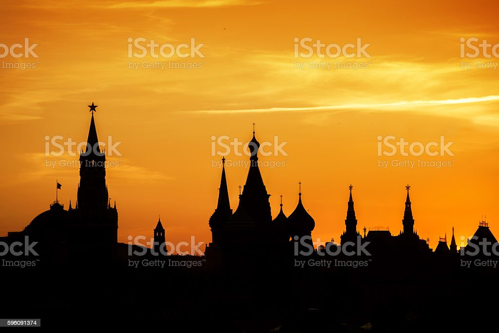 Silhouettes of Moscow Kremlin at Red square on sunset stock photo