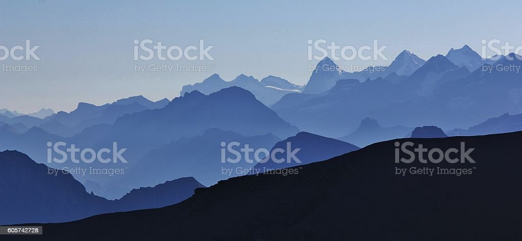 Silhouettes of mountains and valleys in the Bernese Oberland stock photo