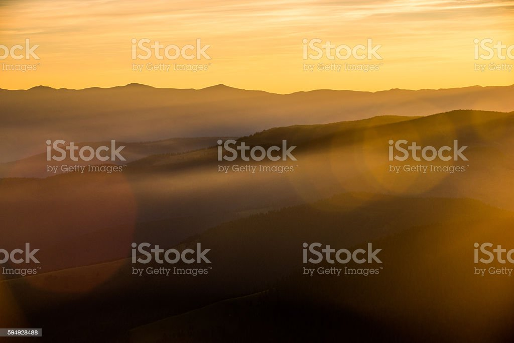silhouettes of mountains background stock photo