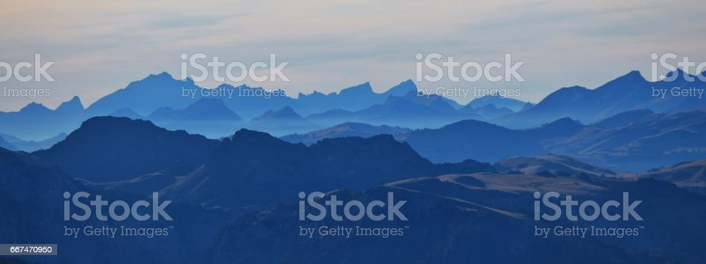 Silhouettes of mountains in the Swiss Alps stock photo