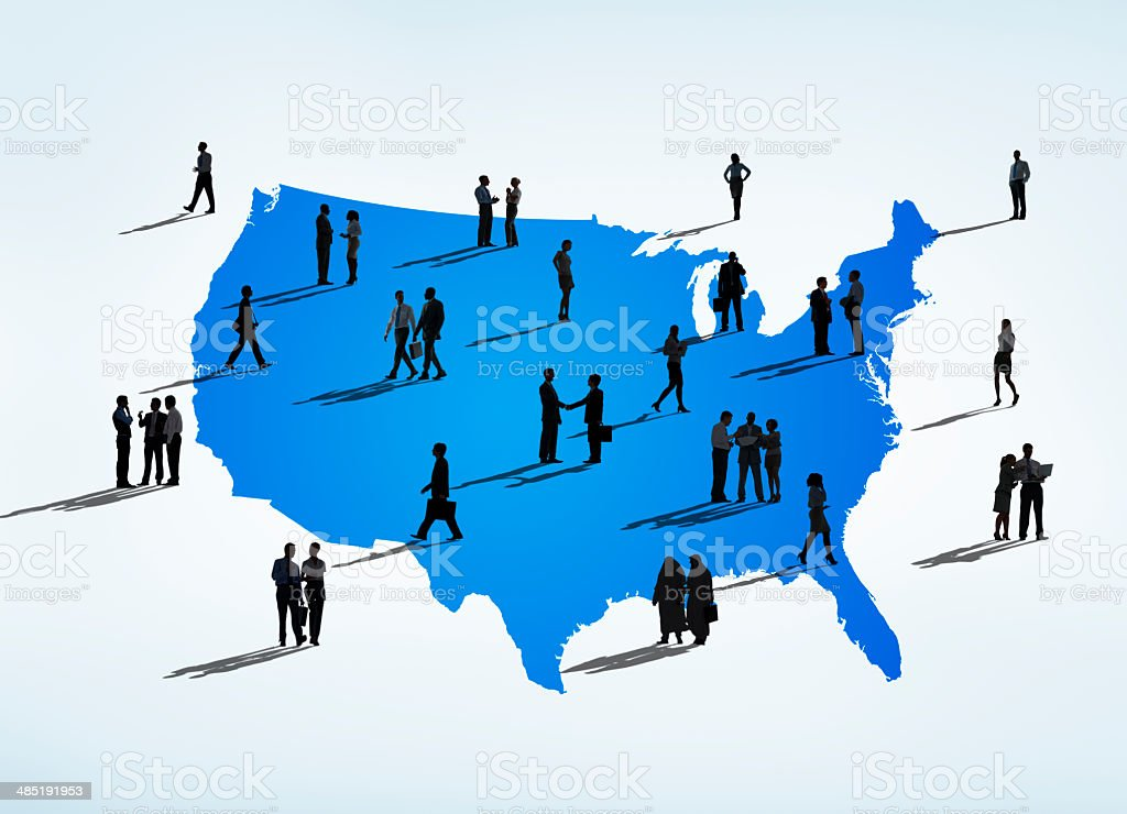 Silhouettes Of Multi-Ethnic Business People On A Blue Cartograph stock photo