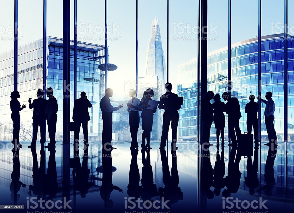 Silhouettes Of Multi-Ethnic Group Of Business People Working Tog stock photo