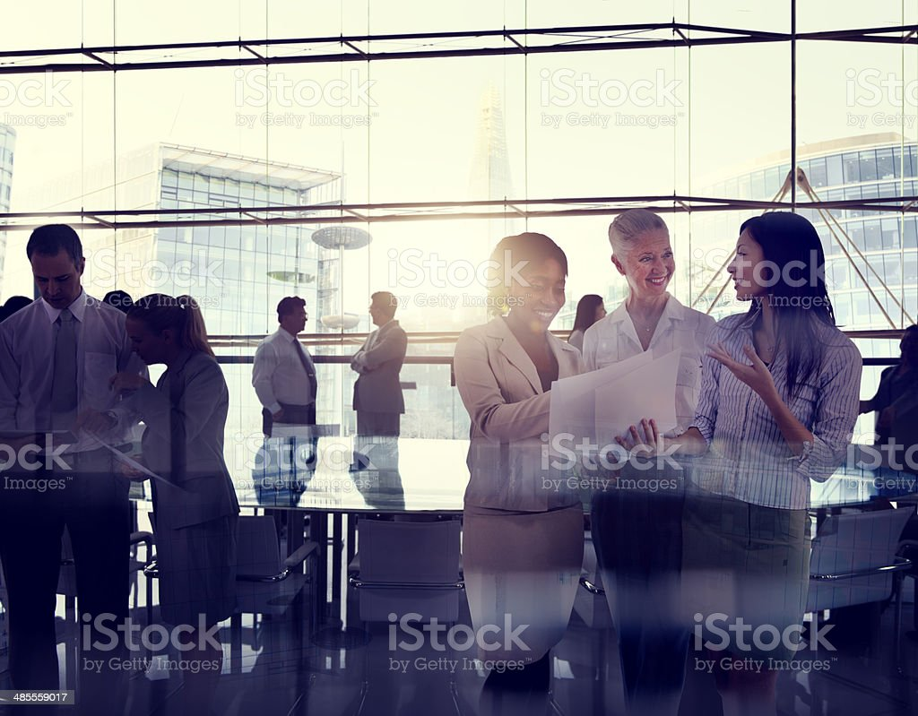 Silhouettes Of Multi-Ethnic Group Of Business People Working Together...
