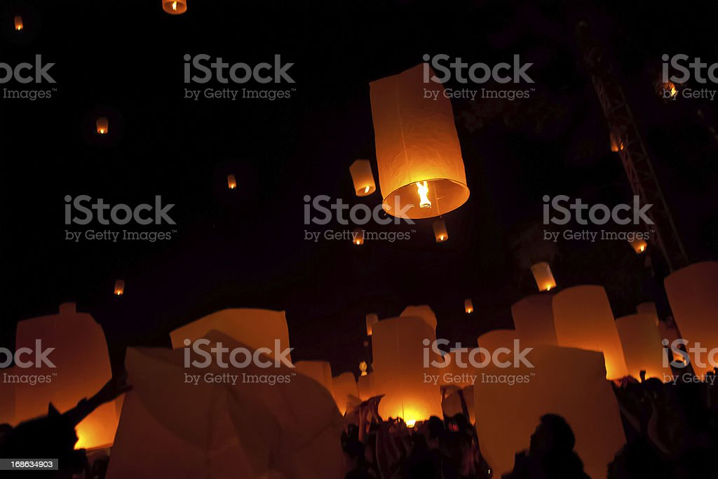 Silhouettes of people and dim lighting at Loi Krathong stock photo