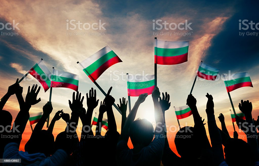 Silhouettes of People Holding Flag of Bulgaria stock photo