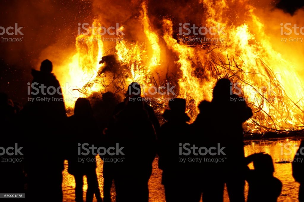 Silhouettes of people in front of easter fire stock photo