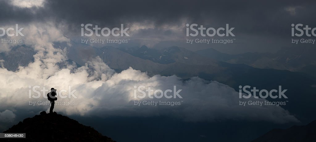 Silhouettes of people in the mountains stock photo