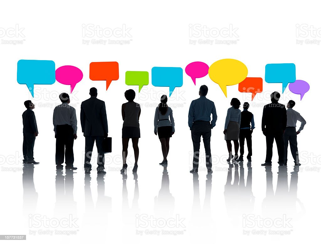 Silhouettes of people with colored speech bubbles above them royalty-free stock photo