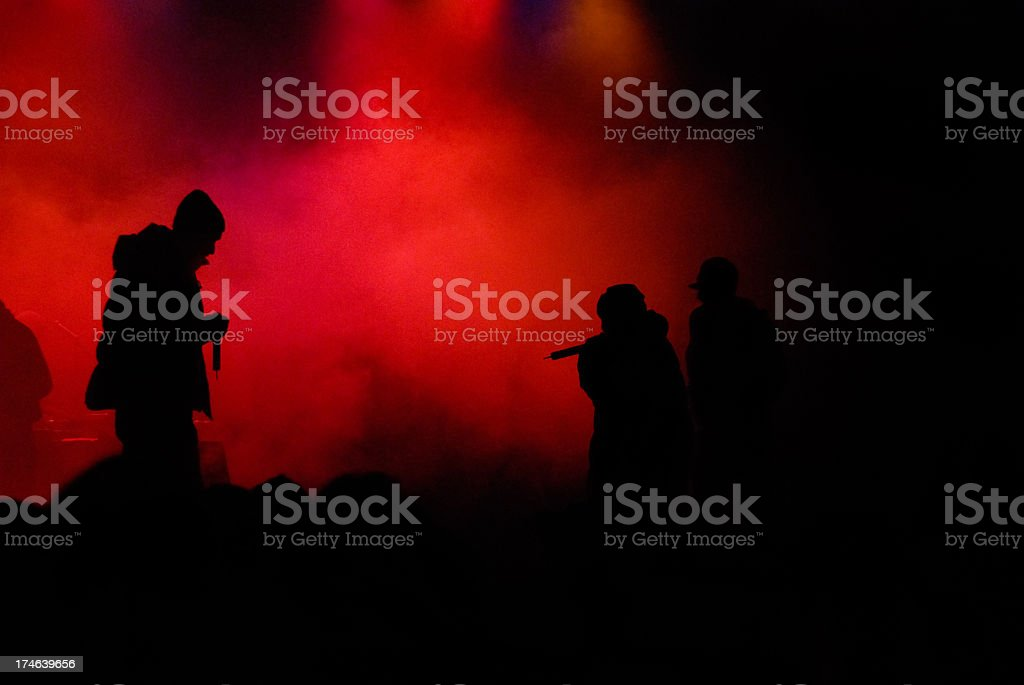 silhouettes of rappers on stage stock photo