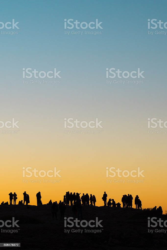 Silhouettes of tourists at sunset at the Cape Saint Vincent stock photo