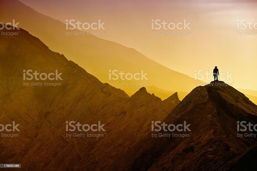 Silhouettes of tourists hiking on Bromo mountain stock photo