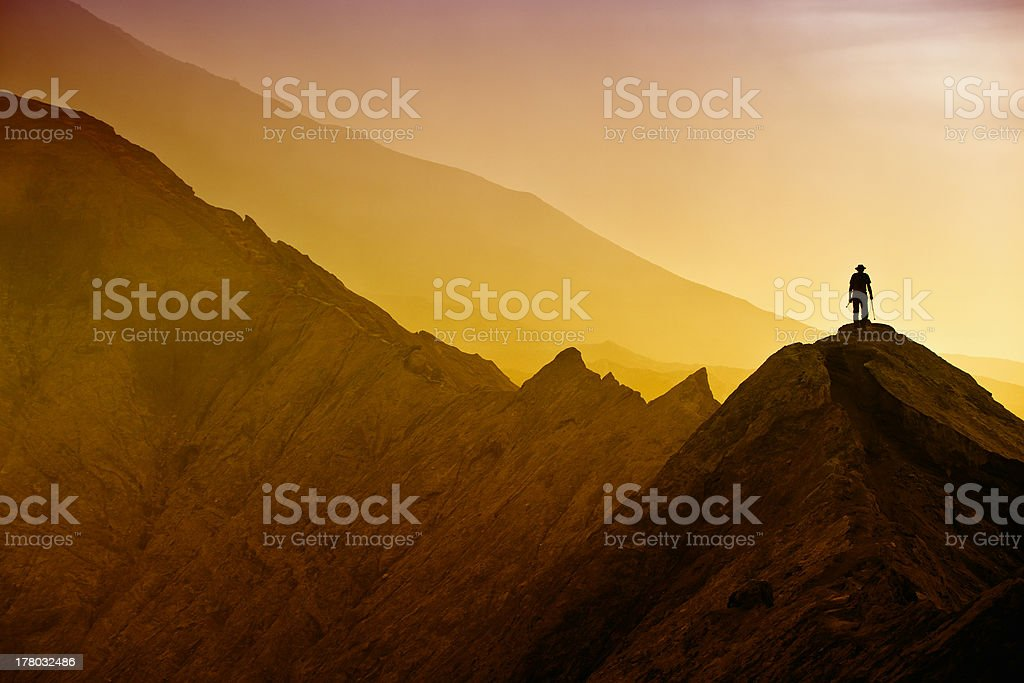 Silhouettes of tourists hiking on Bromo mountain stock photo