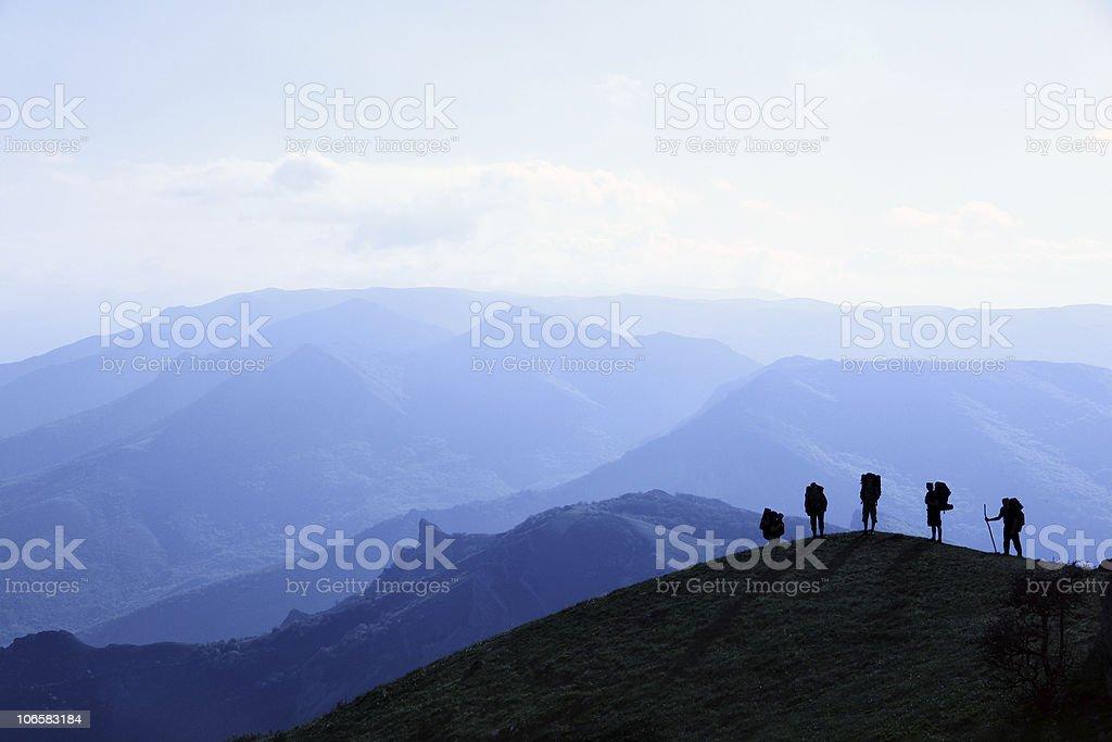 silhouettes of tourists stock photo
