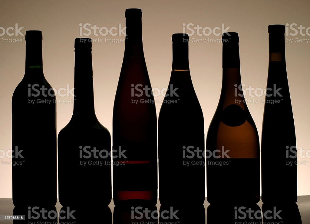 Silhouettes of various wine bottle shapes royalty-free stock photo