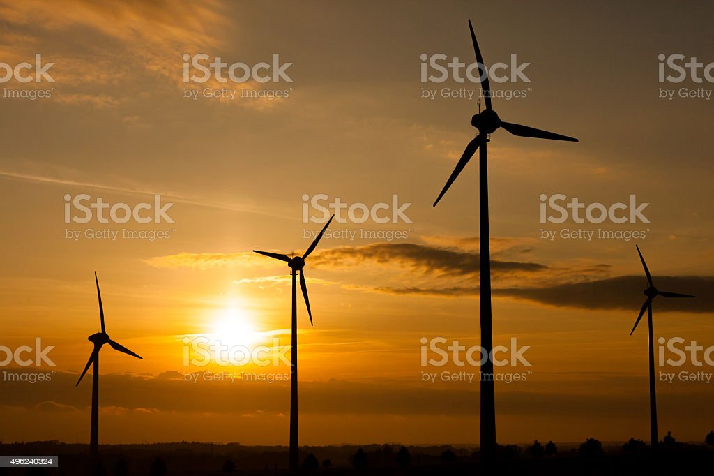 Silhouettes of wind turbines in Wolgast, Germany stock photo