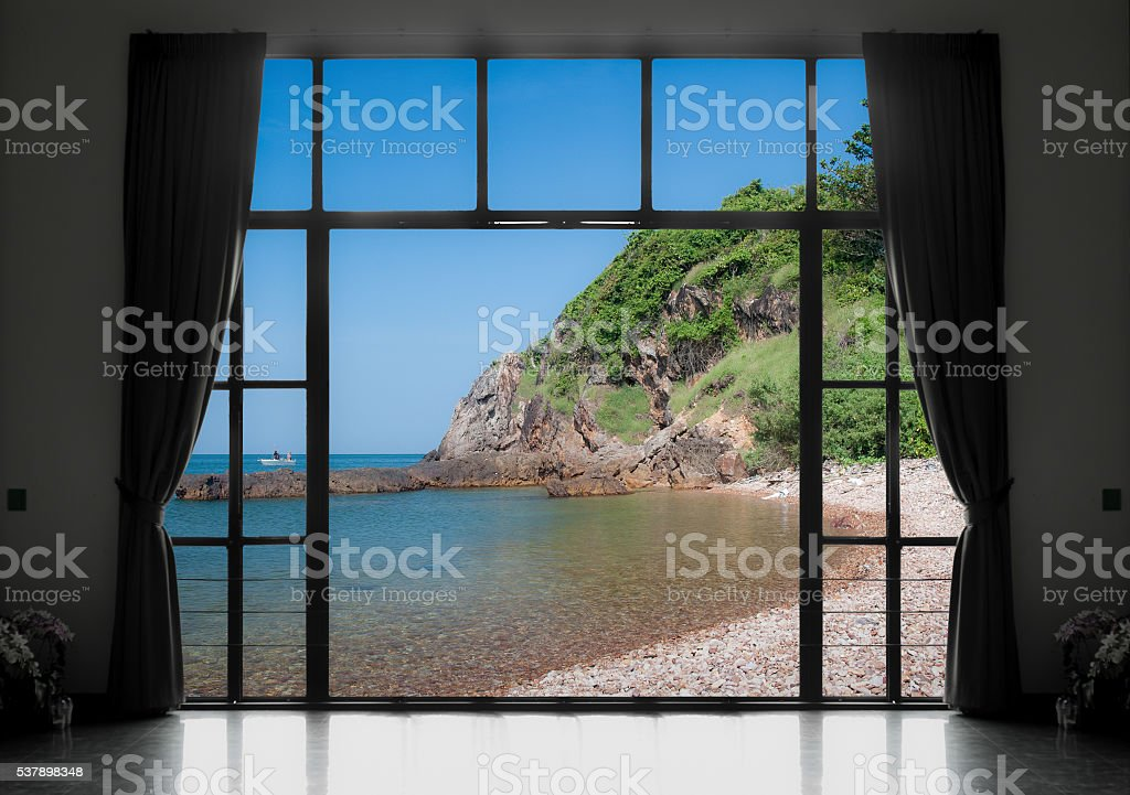 Silhouettes of window with a curtain, sea view background stock photo