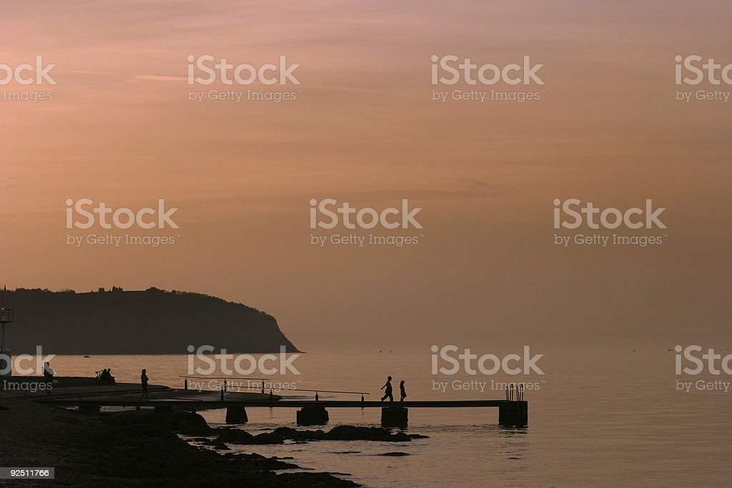 Silhouettes on the pier royalty-free stock photo
