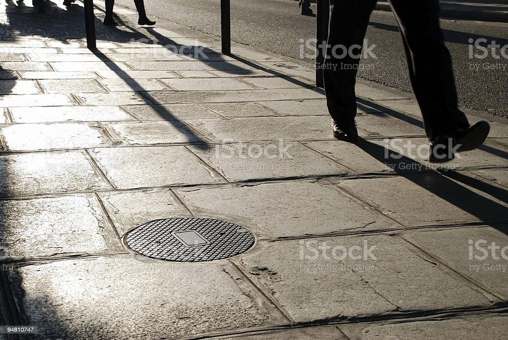 Silhouettes walking royalty-free stock photo