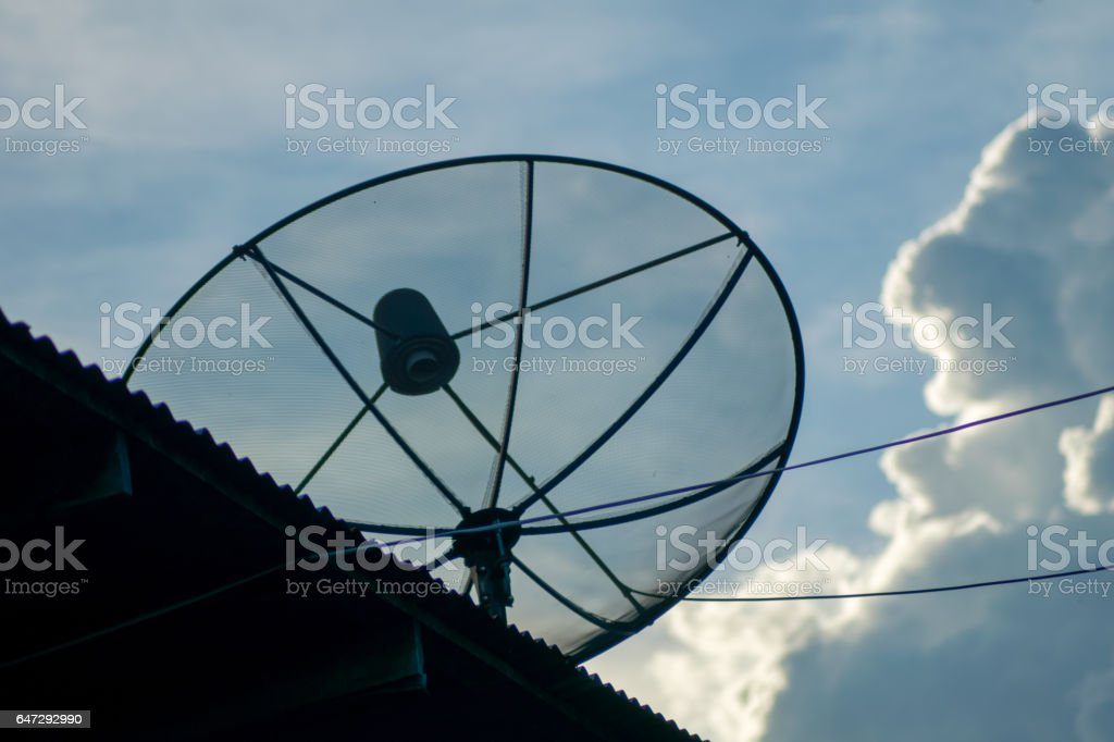 Silhouette,satellite dish on the house stock photo