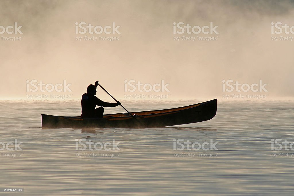 Silhoutte of a canoeist stock photo