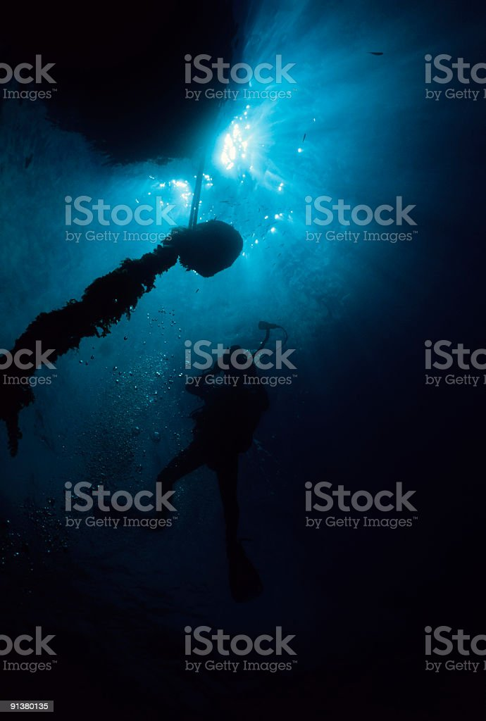 Silhoutte Of Underwater Diver royalty-free stock photo