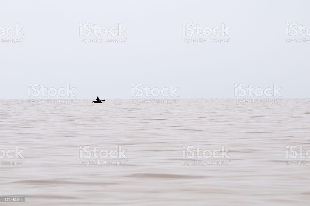 Silhoutte paddling on Lake Tana, Ethiopia stock photo