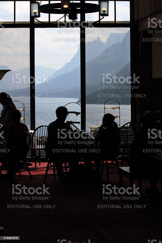 Silhoutte view inside Prince of Wales Hotel toward Waterton Lake stock photo