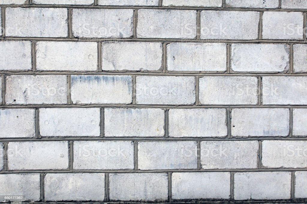 silicate white brick wall with grey gray seams stock photo