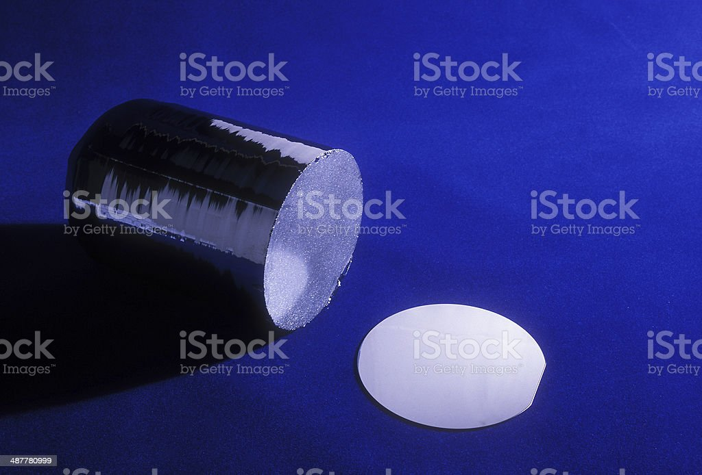 4' Silicon Ingot and 4' Silicon Wafer stock photo