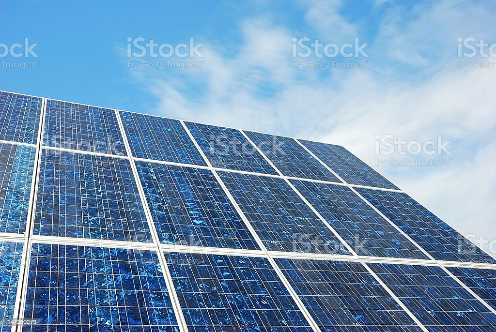 silicon solar cells with blue sky showing crystals stock photo