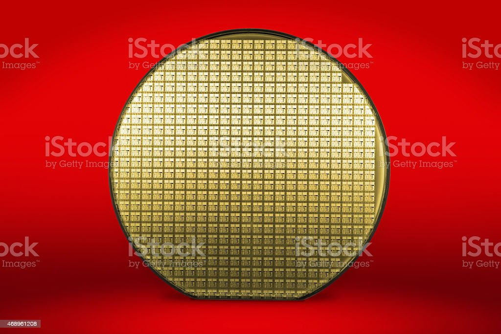 Silicon wafer on red background stock photo