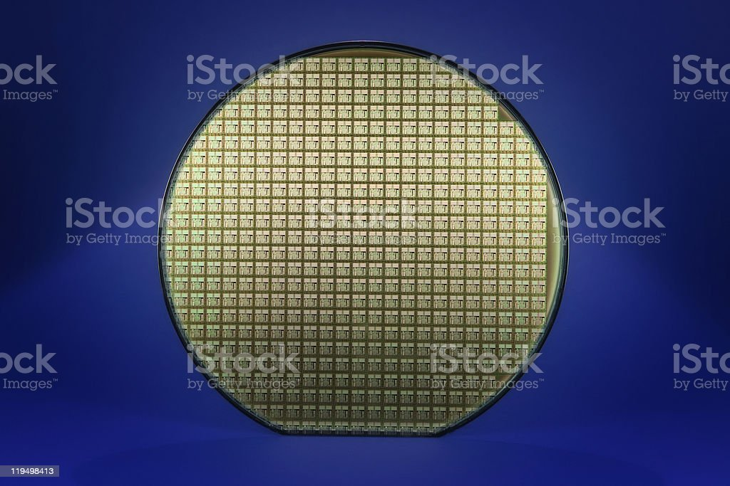 Silicon wafer with dark blue background stock photo
