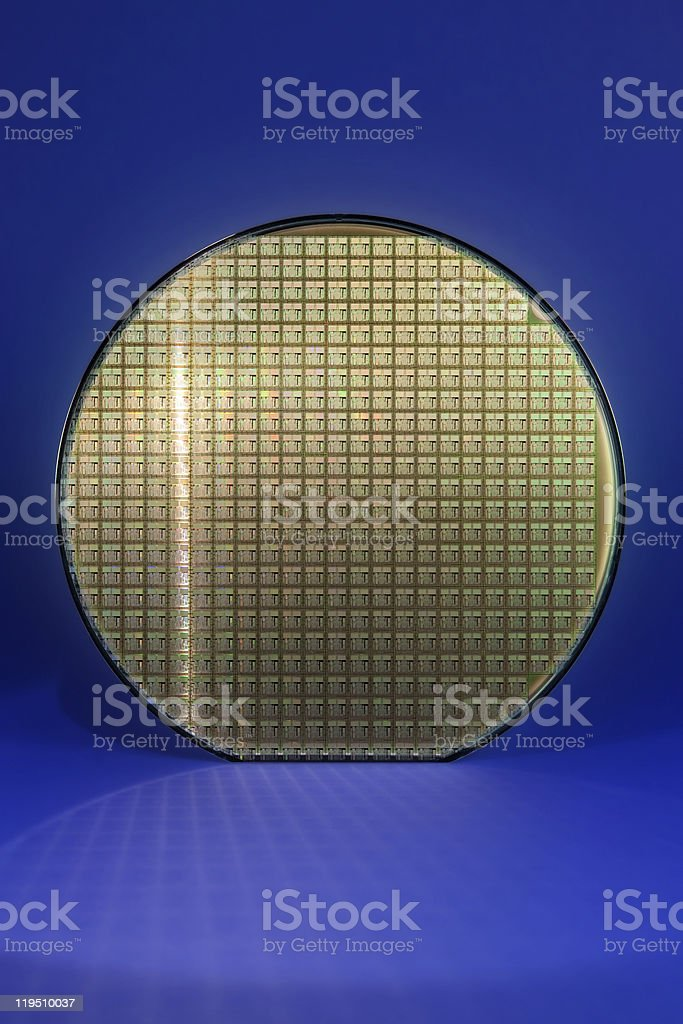 Silicon wafer with reflected chip grid stock photo