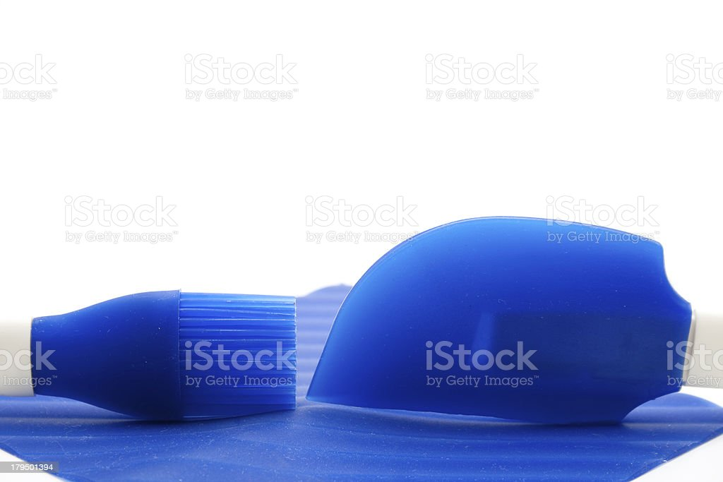 Silicone cake brush and scraper royalty-free stock photo