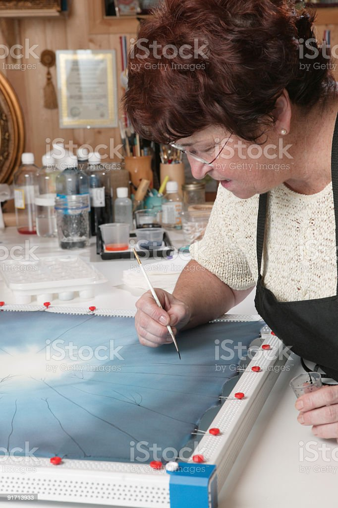 silk artist working stock photo