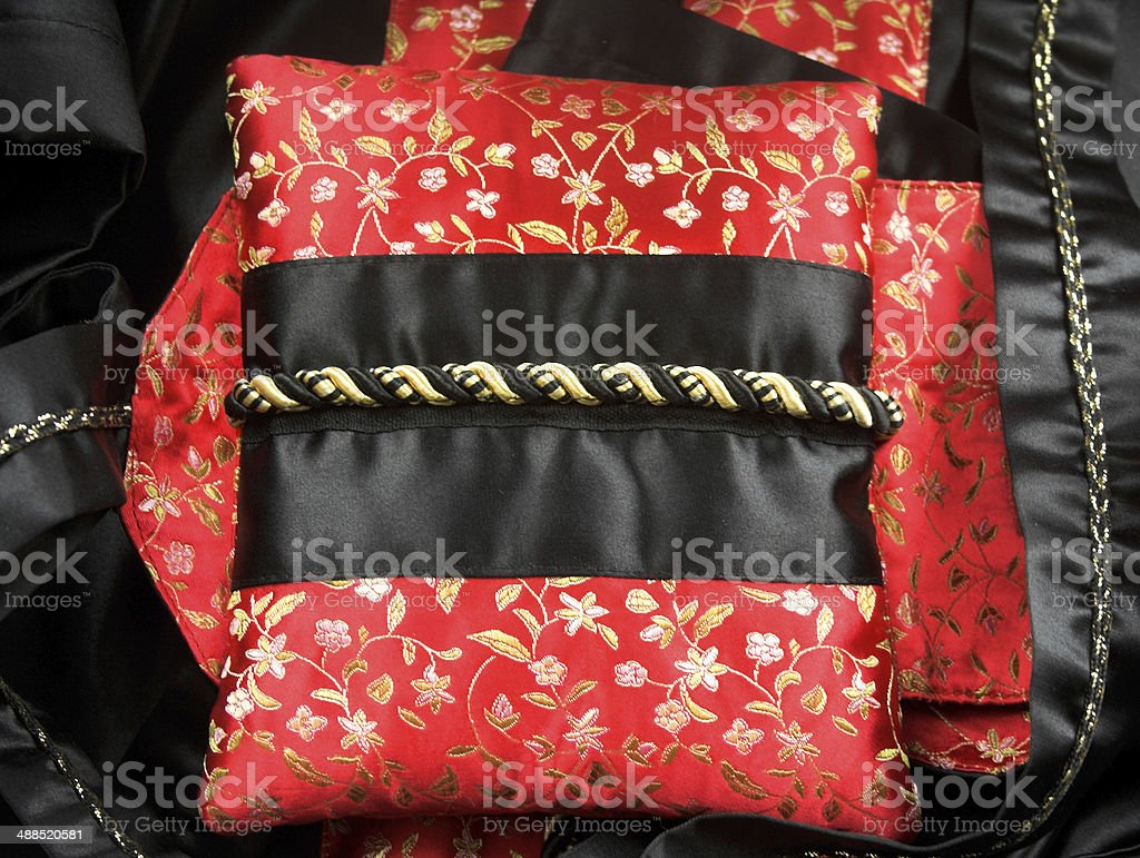 Silk black and red pillow stock photo