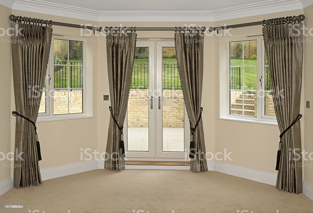silk curtains and bay windows stock photo