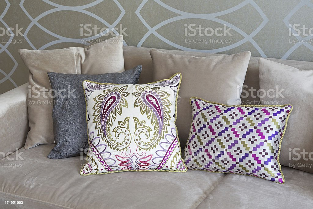 silk cushions on a couch stock photo