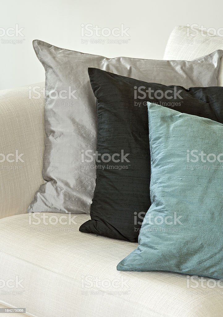 silk cushions on a settee royalty-free stock photo