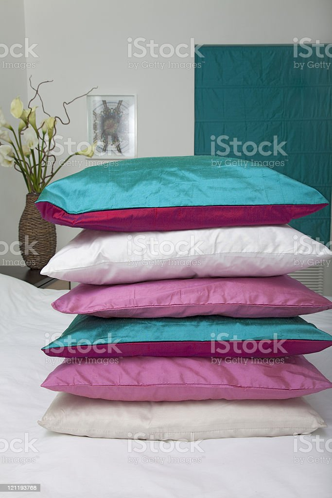 Silk cushions on bed royalty-free stock photo